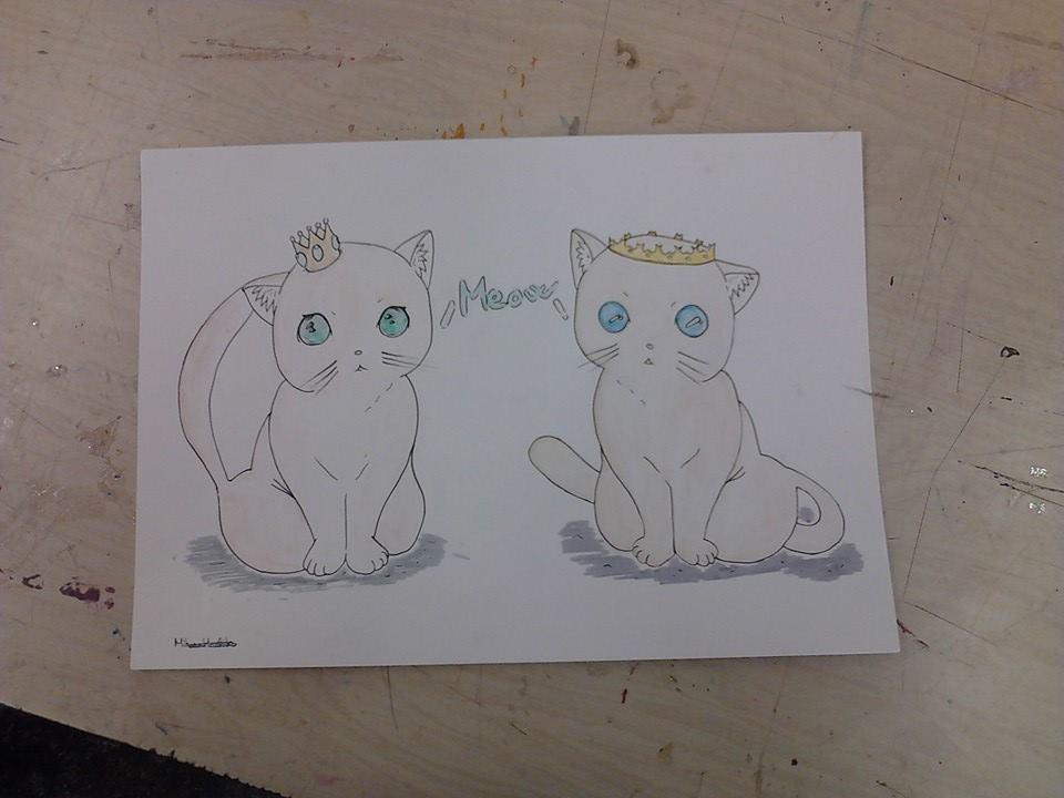 Deux chatons couronnés par Angélique